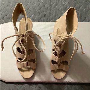 WOMEN'S Wedge tie top heels.